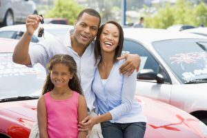 Family collecting new car from lot